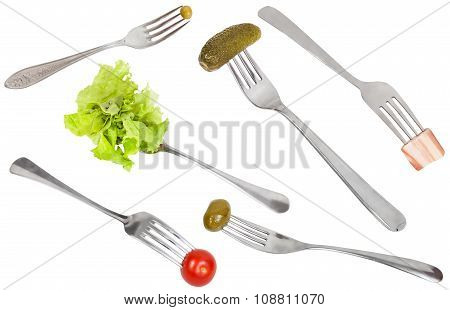 Set Of Forks With Impaled Foods Isolated