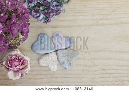 Four Leaf Clover Figured With Soap Stone Hearts And Dried Blossoms