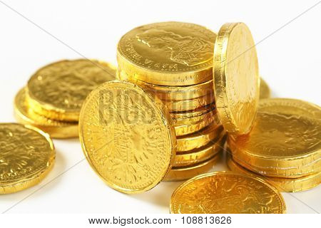 detail of golden chocolate coins stack