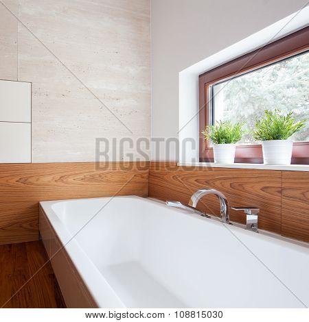 White porcelain bath in modern wooden washroom poster