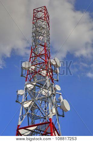Communication antenna tower on blue sky closeup poster