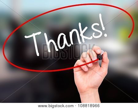 Man Hand writing Thanks! with marker on visual screen.