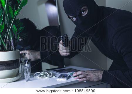 Masked Intruder With Gun