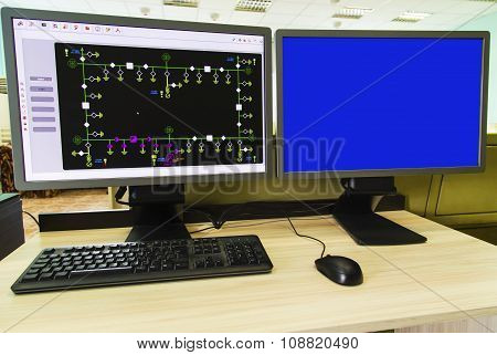 Computers and monitors with schematic diagram for supervisory, control and data acquisition