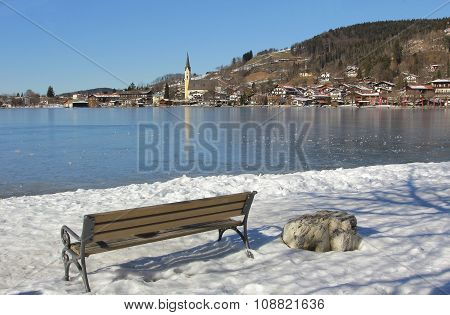 Lake Schliersee Frozen Over, Resting Bench With View To Spa Town