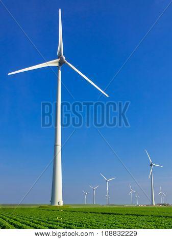 Wind Turbine In Dutch Landscape
