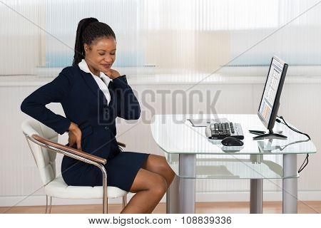 Businesswoman Suffering From Neckache