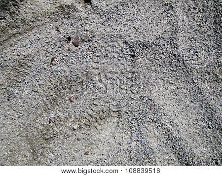 Footprint in grey gravel close-up texture (evidence of crimeъ poster