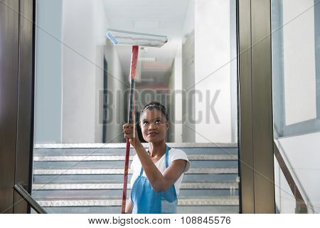 African Woman Cleaning Glass
