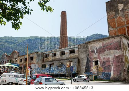Abandoned factory building with graffiti art. Kotor it is a very popular travel destination of Europ