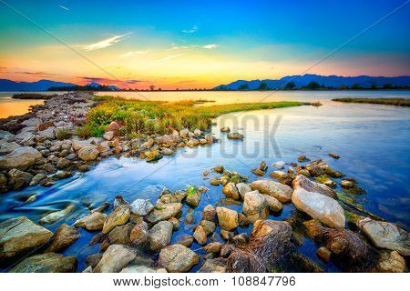 Beautiful Summer Sunset Over The Rocky Shore By The Sea. Hdr Image