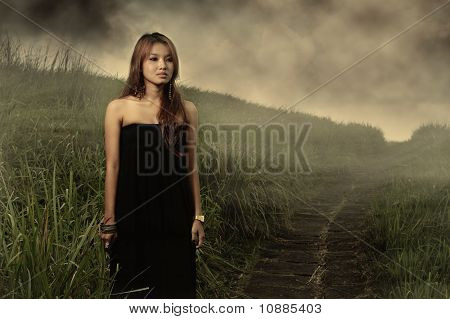 asian woman outdoor with black dress