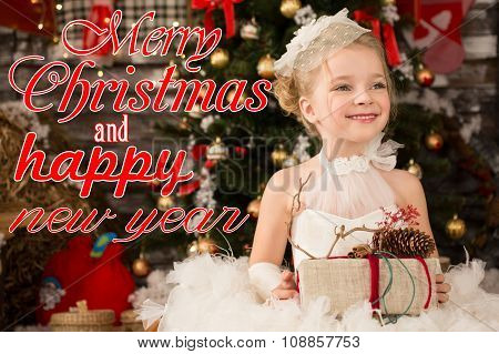 Cute Young beautiful girl in white Christmas dress is taking Chr