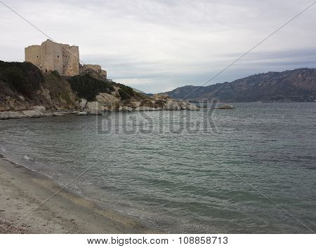 A Castle in front of the sea in a cloudy day in Villasimius
