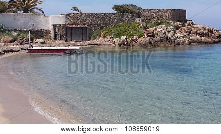 Beach And Blue Sea Colorful Sardinia With House In The Background