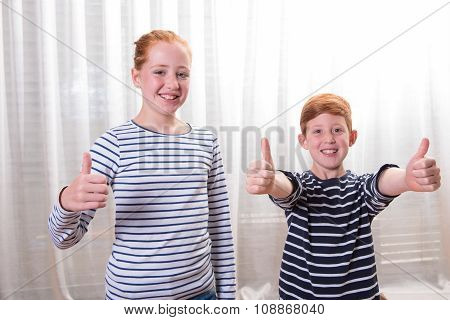 Brother And Sister Smiling And Having Thumbs Up