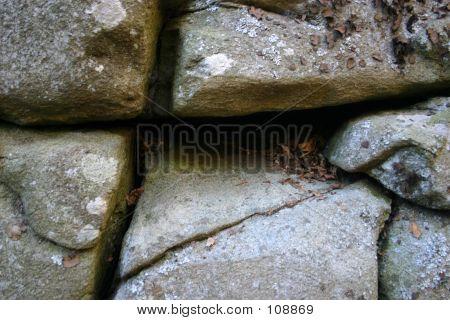 Cross Formed By Voids In Rock