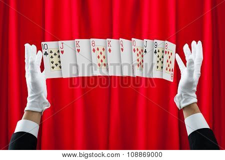 Hands Of Magician Performing Trick With Cards