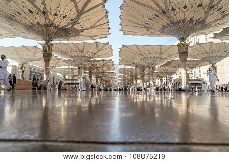 Pilgrims Walk Underneath Giant Umbrellas At Nabawi Mosque