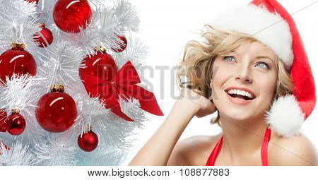 portrait of attractive  caucasian smiling woman blond isolated on white studio shot  new year tree red balls christmas santa's hat