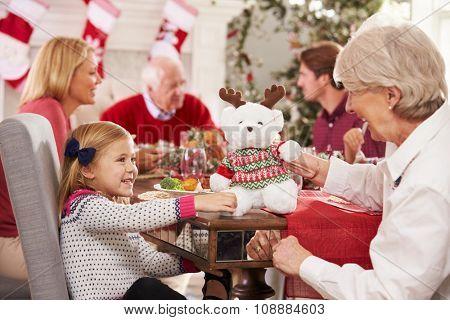 Granddaughter With Grandmother Enjoying Christmas Meal