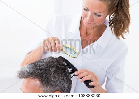 Dermatologist Looking At Patient's Hair