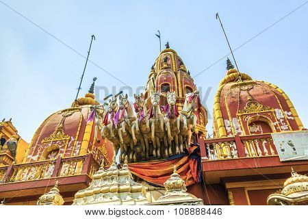 NEW DELHI, INDIA - MAY 7, 2013: Temple entrance presided by a statue of Surya