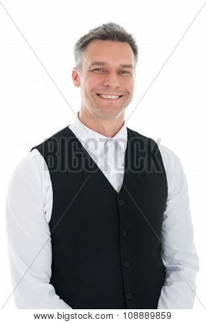 Portrait Of Happy Mature Waiter