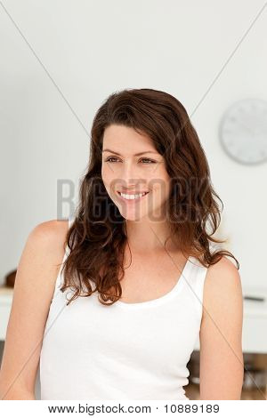 Portrait Of A Beautiful Woman Standing In Her Kitchen
