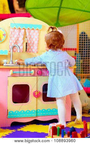 Little Hostess At Toy Kitchen In Kindergarten