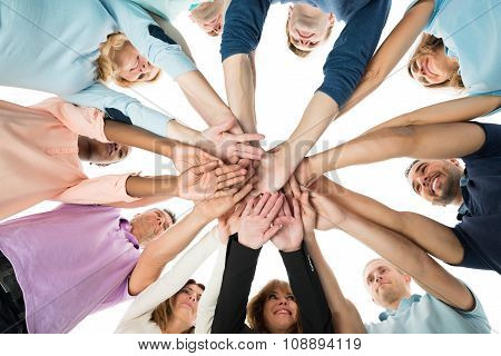 Creative Business Team Stacking Hands In Huddle