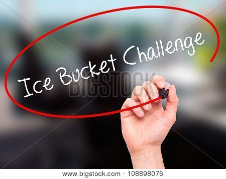 Man Hand writing Ice Bucket Challenge  with black marker on visual screen.