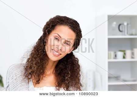 Portrait Of A Pretty Woman Standing In Her Kitchen