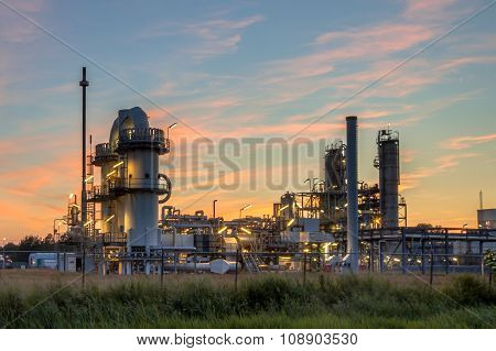Heavy Industrial Chemical Factory At Sunset