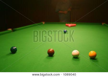 Snooker-Break Player Chalks Cue