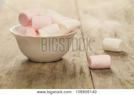 Sweet Marshmallows On White Plate On Wooden Background