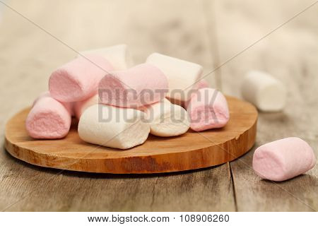 Sweet Colorful Marshmallow On Cutting Board On Wooden Background