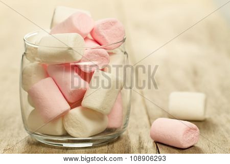 Sweet Colorful Marshmallows On Wooden Background