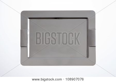 Stylish stainless steel tray with rounded chamfered corners and integrated handles for use in catering to serve food and beverages overhead view isolated on white poster