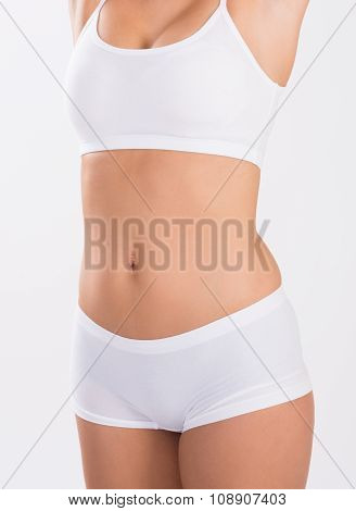 Midsection Of Woman In Innerwear
