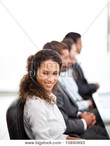 Happy Representative With Her Colleagues Working In A Call Center