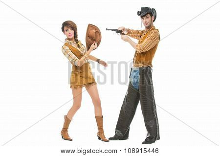 Cowboy and cowgirl with gun
