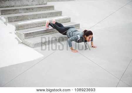 Strong Fitness Urban Woman Doing Push Ups