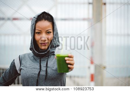 Urban Fitness Woman Holding Detox Smoothie Drink On Workout Rest