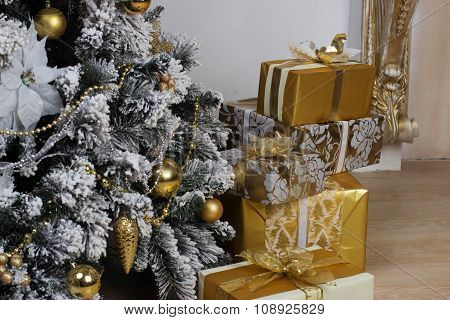 Christmas decorations on spruce with gifts indoors