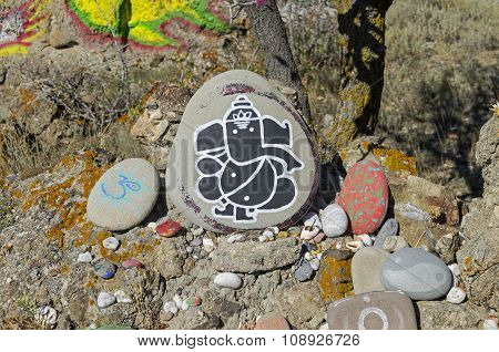 God Ganesha - Drawing On A Stone In A Makeshift Altar.