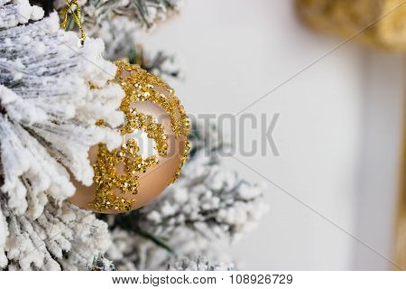Christmas Decoration Concept. Gold Ball Hangs On Spruce