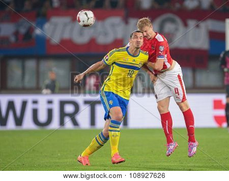 VIENNA, AUSTRIA - SEPTEMBER 9, 2014: Martin Hinteregger (#4 Austria) and Zlatan Ibrahimovic (#10 Sweden) fight for the ball in an European Championship qualifying game.