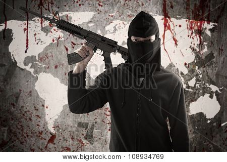 Man Holds Rifle With Bloody Map