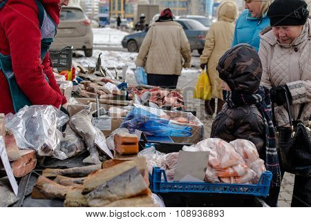 Young Russian Boy Looks At Fish Seller